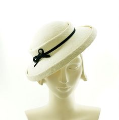 This is a stylish saucer hat for women, completely handmade by me using classic millinery techniques. A vintage style hat in the fashion of the