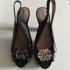 Vince Camuto Slingback Heels - Size 9.5 This is a pair of gorgeous Vince Camuto Slingbacks with stacked heels. The heel measures 2.5 in and the sling has a short elastic for added comfort. Worn only twice for special occasions. Vince Camuto Shoes Heels