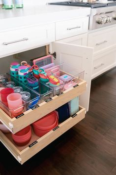 Our Home : The Kids Cabinet - Mika Perry - cabinet organization Home Organisation, Kitchen Organization, Organization Hacks, Kitchen Storage, Toy Closet Organization, Baby Bottle Organization, Water Bottle Storage, Kitchen Racks, Medicine Organization