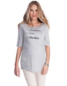 <ul> <li> Ultra soft viscose </li> <li> Relaxed fit </li> <li> Scooped neckline </li> <li> Curved hemline </li> </ul> <p> Rock our trendy slogan tee and say yes to chocolate! Made in the softest stretch viscose, this chic grey marl t-shirt offers a relaxed slouchy fit that's perfect for every stage of pregnancy. Team it with sandals and skinny jeans for an effortless daytime look, or amp up the style with a pair of our Faux Leather Panel Maternity Leggings and a classic red lip. No…