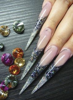 Nailed: Dzine's Elaborate Manicures -- intriguing photo essay on nail design from around the world. I think these particular nails qualify as a weapon ;)