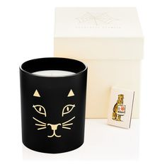 The Kitty Candle fills your home or office with the essence of Charlotte Olympia. Notes of oak moss, Indonesian patchouli and vanilla bourbon perfume the air while this purrrfect candle decorates any surface. | Charlotte Olympia