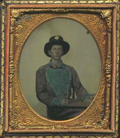 "James Henry Woodson served in Co. H (The ""Appomattox Rangers""), 2nd Virginia Cavalry. Woodson wears a uniform similar to that of the Lynchburg infantry companies. His company was raised in Appomattox but was mustered into state service in Lynchburg and was perhaps outfitted there as well. Sixth-plate hand colored melainotype. Confederate Blue and Yankee Grey - History Forum ~ All Empires - Page 8"