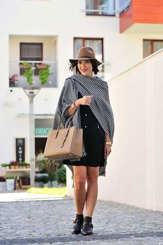 Wear your blanket scarf as a cape, then drape it over one shoulder to look super chic.