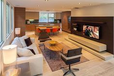 Meryl Streep Sells a Home to A-Rod. The Lounge A floating shelf beneath a second flatscreen TV provides storage for unsightly cords, tech gadgets, and DVDs. Celebrity Kitchens, Celebrity Houses, Meryl Streep House, California Homes, Living Area, Living Rooms, Family Rooms, Elle Decor, Midcentury Modern