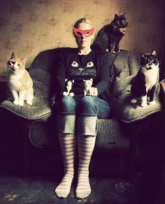 cat woman or crazy cat lady, maby every crazy cat lady is an cat woman inside.