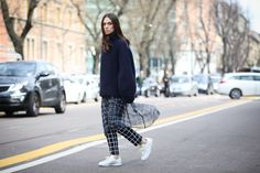 90+ Outfits That Are All About The Shape #refinery29  http://www.refinery29.com/2015/03/83106/milan-street-style-mfw-2015#slide-16  The controversial skirt-over-pants becomes understated with sheer fabrics and a heavy sweater.Dondup shirt and pants; Berenika Czarnota sweater.