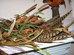 antler mantle arrangement | few springs of seasonal florals.