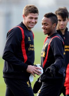Captain crunch: Gerrard acts as Sterling's minder on the pitch
