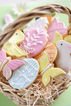 Elegant Easter Centerpiece Ideas. An unadorned basket filled with elaborately frosted cookies will engage the eyes of all the little ones at the table.