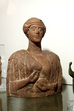Terracotta bust of a woman holding a flower and a pomegranate. Culture/periodWestern Greek  Date450BC (circa)