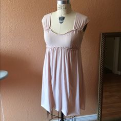 """Vintage Anthro baby doll dress Very light pink, baby doll style dress from Anthropologie. Cap sleeves which can be scrunched to straps if wanted. Extremely soft and comfy. 100% cotton. Worn once. Slightly sheer, just need to wear nude panties and you're fine. Raw cut, unfinished hem. Tiny hole at back neck where tag is, unnoticeable. Other than that, perfect condition. Bust flat is 16.5"""". Elastic under bust 14"""", stretches to 23"""" easily. Length from underarm 26"""". M but could fit L easily…"""