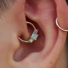 Opals filled with moon magic. Daith piercing by @perrymdoig #ootd #goldforeverybody #cuteclients