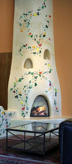 Fireplace - Kiva fireplace with colorful leaf designs