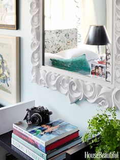 Mirror - A brown plastic mirror — vastly improved after three coats of chalky white paint — now looks very French 1940s, and it visually expands the space  Read more: Silver Nut Bowls - Studio Apartment Decorating Ideas - House Beautiful