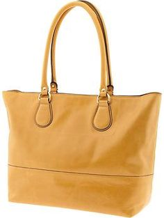 Great bag and it fits a 15 inch laptop--  truly amazing how yellow goes with so many things.  Joanna tote | Banana Republic