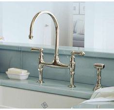 Rohl Double Handle Bridge Kitchen Faucet with Sidespray from Perrin & Rowe, in Polished Nickle. http://www.remodelworks.com/