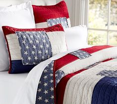 Patriotic bed linens from Pottery Barn. The hand pick-stitched stars and stripes deconstruct the flag with a vintage Americana feel.