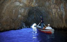 La Grotta Azzurra, Capri. Beautiful cave on the isle of Capri, Italy. To reach the cave you take a boat from mainland Italy (eg Sorrento) to Capri. Then take a smaller boat from Ana Capri (the port) round the isle to the cave entrance. You hen transfer into a rowing boat and lie flat as you are pulled inside the cave. Most brilliant blue water.