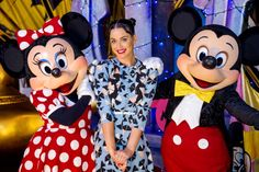 Katy Perry poses with Minnie Mouse and Mickey Mouse at Disney's Hollywood Studios at Walt Disney World Resort on July 4, 2014 in Lake Buena Vista, Florida.