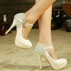 These heels are so pretty.. I love the little sequins / gems on the actual heel.