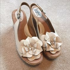 NWOT BOC leather cork wedges Price FIRM. NWOT BOC by Born leather cork wedges with flower! I love these comfortable shoes and this brand stands the test of time! Beige in color. Item# 642 Born Shoes Wedges