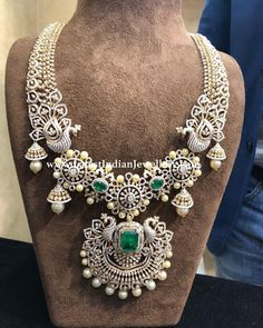 A beautiful fusion of diamonds, emeralds and south pearls in bridal diamond necklace featuring peacock design in interesting pattern. Diamond Necklace Set, Diamond Bracelets, Diamond Pendant, Diamond Jewelry, Cartier Bracelet, Emerald Necklace, Pearl Diamond, Bangles, Necklace Designs