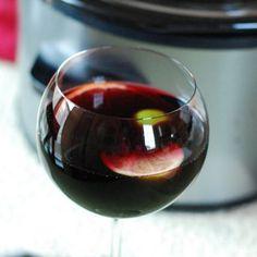 Slow-Cooker Winter Sangria Recipe Beverages with red wine, orange, brandy, simple syrup, triple sec, lime, lemon, orange