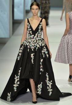 A elegant silhouette, beautiful bustle bowed back and the most delicate flowers make this Ralph & Russo dress a real winner