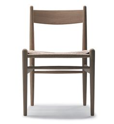 Wegner CH36 Chair . CH36 Chair by Hans J. Wegner  Designer: Hans J. Wegner (1962).  Manufactured under license in Denmark by Carl Hansen & Son. BEECH WITH NATURAL SEAT .