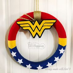 felt creations Hello and welcome to Felt Happens! All my felt creations are made by hand with lots of love. These creations are MADE TO ORDER, and since everything is by hand, please al Wonder Woman Birthday, Wonder Woman Party, Wonder Woman Logo, Handmade Felt, Handmade Items, Superhero Door, Dad To Be Shirts, Handmade Home Decor, 4th Of July Wreath