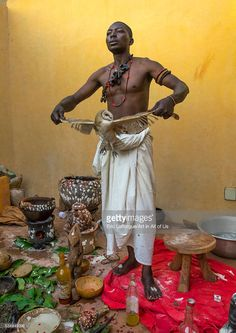 Benin, West Africa, Bonhicon, kagbanon bebe voodoo priest with a owl during a ceremony