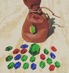 Have you cut any grass recently? Need to save up those rupees in today's world! What would you do if you found a gold rupee and you could spend it in real life? Pity it won't go far these days! These little resin rupee bags are so cute. Perfect for cosplay!! #zelda #zeldanation #rupee #money #loz #legendofzelda #zeldabreathofthewild #zeldacosplay #zeldaart #zeldamemes #zeldafans #oot #majorasmask #nintendo64 #gameboy #nintendo3ds #nintendoswitch #link #gaming #gamer #games #ganon #cash…