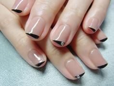 Black funky diagonal french tips nail art design with rhinestones