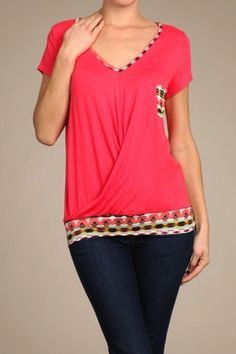 *** Trim Tribal Tee *** Short sleeved solid colored top with tribal details on sections of top.