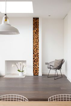 fireplace stacked logs | Annis Road by Scenario Architecture