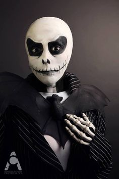 Created this look with a bald cap covering my ears, white and black makeup using the Mehron Professional Paradise Pallet, black contact lenses, skeleton gloves, a bat decoration from Walmart I sprayed black and a striped jacket.