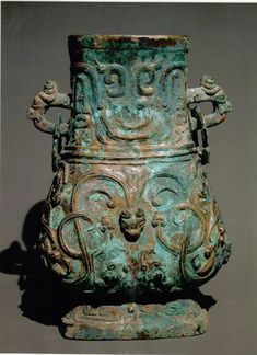 """The 42.3-centimeters-high pot, one of the bronze artistic gems in ancient China, is intricately embellished. Around the inner brink of the pot are two lines of Chinese characters meaning """"it was the Duke of the State Qin that had the pot made."""" Experts confirmed that the pot was made as a ritual vessel for the Duke of the State Qin, a ducal state in late Western Zhou Dynasty."""