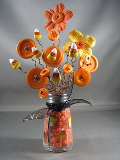 "These are my Halloween series. I call this one Crazy for Candy Corn.  ~~~~~~~~~~~~~~~~~~~~ I love creating what I call my ""Button-Lee"" Bouquets. They measure anywhere from 2-10 in height. Prices range from $3 to $75. Each one I make, I take great pride in. It takes days to create them. I want them to be beautifully appealing to the eye. They look great anywhere! Your desk. On a bookshelf or mantel. They can make great gifts for young ones and adults alike. Each bouquet is one of a kind…"