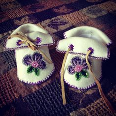 Baby booties made with white Melton and beadwork