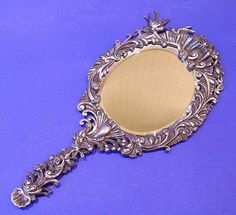 French Silver Hand Mirror. Made circa 1880.
