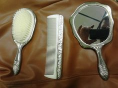Beautiful Vintage Ornate Heavy Silver Plated Hair Brush Comb Hand Mirror Set | eBay    I found the comb today! I'm really happy it's made of silver~