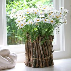 Bring some of the outside in, with this eco-friendly twig vase DIY at Nini Makes.  What a cheap, creative way to display your wildflowers, or gift that gorgeous bouquet.