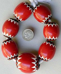 Seven large Venetian 5-layer red chevrons Size from: 28 x 24mm to 34 x 30mm Circa 1920 - 1930 - Price: $425.00