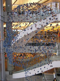 SLC Public Library, Interior | This head profile sculpture is made up of hundreds of hanging books and butterflies that create this image.