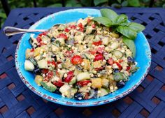 Summer Corn Salad with red bell pepper, cherry tomatoes, cucumber, avocado, oranges, black olives, grilled zucchini, basil & feta...this salad is Summer in a bowl!