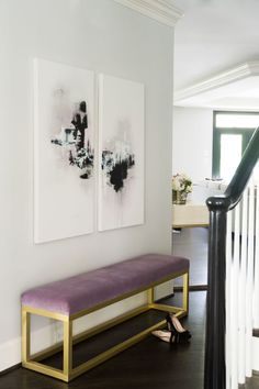 The entryway to Singla's home features a luxe purple and gold bench, accented by the modern artwork hanging above it.