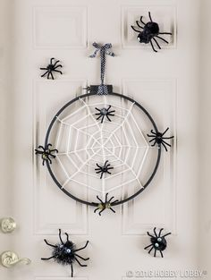 Give your door a spooky update for Halloween using everyday craft supplies like yarn, pom poms and chenille stems!