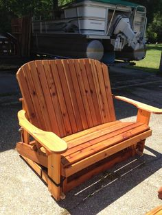 Great use of the Adirondack Chair design on a Bench. Large arms provide a place to have a cup of morning coffee or am ice cold drink as you enjoy the evening gliding away. This is an unstained…MoreMore Adirondack Chairs, Outdoor Chairs, Outdoor Furniture, Outdoor Decor, Woodworking Tools List, Woodworking Projects Plans, Diy Garden Seating, Chair Design, Furniture Design