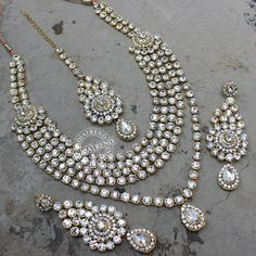 Wedding Bridal Long Necklace and earrings studded with Simulated White Cz and KundanGold Tone, handcrafted with high quality Cz and KundanNecklace measures : Length (approx) -17
